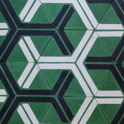 Handmade in Morocco from locally sourced materials using a traditional, 150-year-old technique, these encaustic cement tiles from Popham Design are durable and non-toxic. We love the bright kelly green and bold hexagonal patterning.  Pattern by Lara Deam from Eco-Friendly Tile Designs for Spring