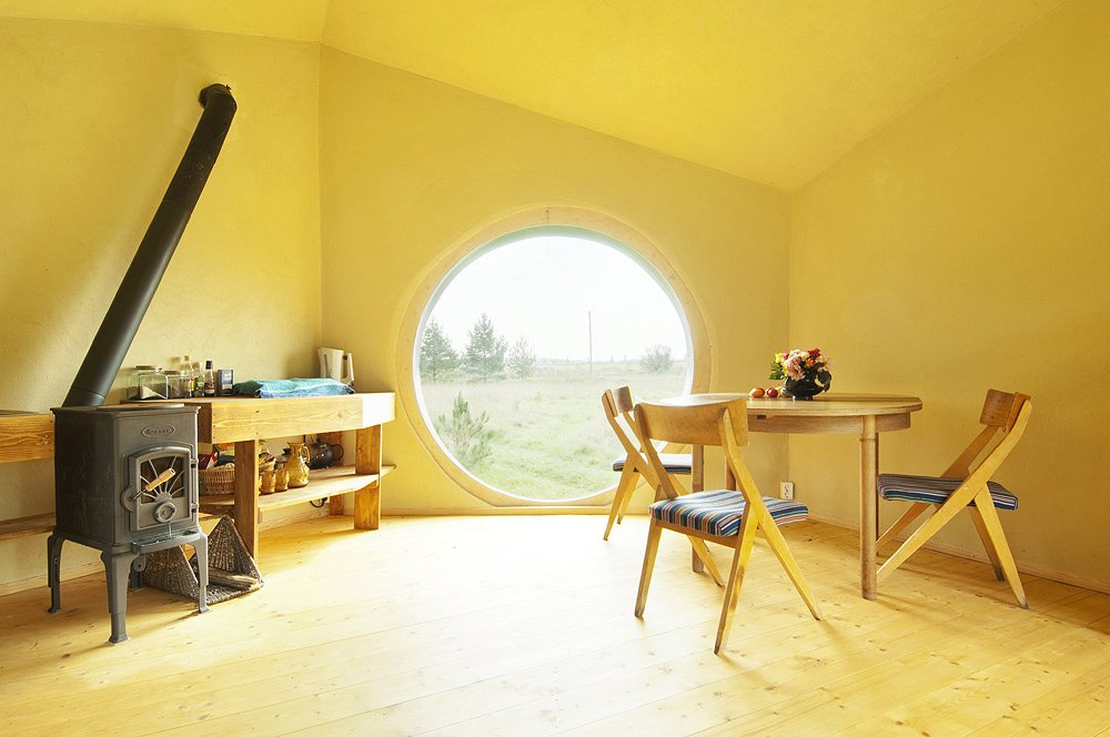 The interior of Jaanus Orgusaar's NOA cabin in the Virumaa region of Estonia. The unique shape of the dwelling creates a very open interior.