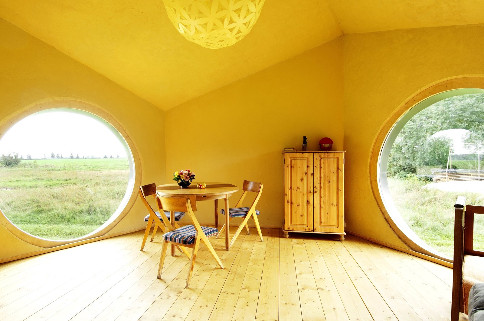 The interior of Jaanus Orgusaar's NOA cabin in the Virumaa region of Estonia. The wide windows provide a great view of the surroundings.  Photo 6 of 10 in Estonian Designer's Tiny Geometric Cabin