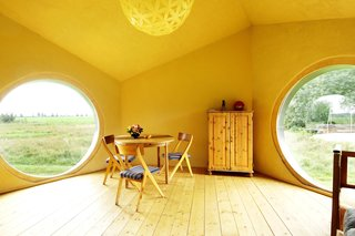 The interior of Jaanus Orgusaar's NOA cabin in the Virumaa region of Estonia. The wide windows provide a great view of the surroundings.