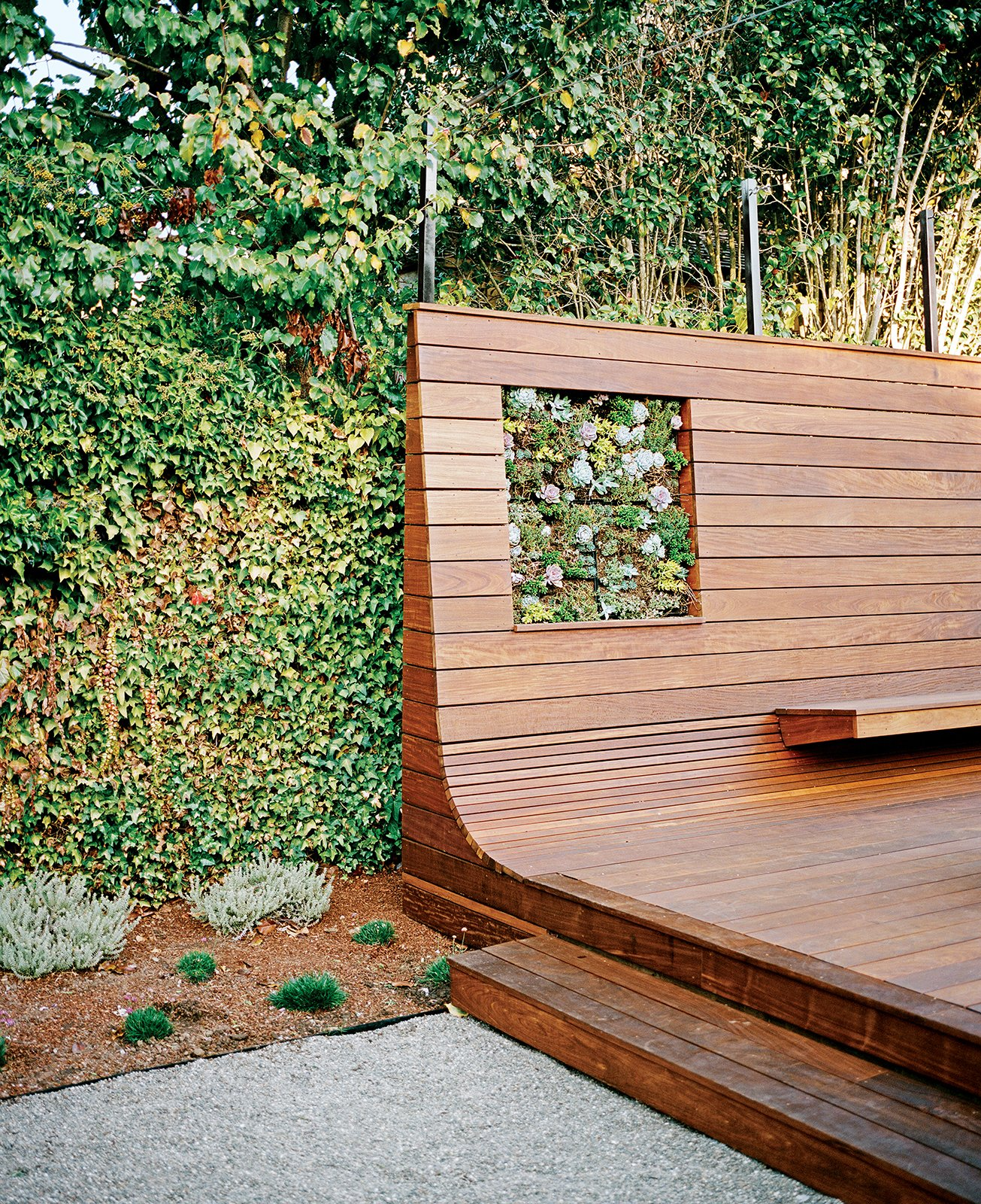 "Cox initially conceived the deck as a conventional surface for relaxing and entertaining. With the bench, however, he seized an opportunity to create something both functional and visually arresting. ""You go down these paths and, as the design mutates, other ideas attach themselves and make it stronger and more interesting,"" he says. Tagged: Outdoor, Wood Patio, Porch, Deck, Small Patio, Porch, Deck, and Back Yard. Bay Area Ipe-Clad Backyard Getaway - Photo 4 of 6"