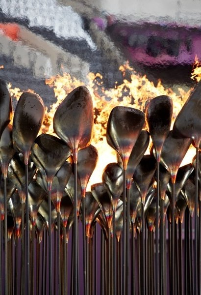 "Olympic CauldronA billion people tuning into the Olympics' opening ceremony meant all eyes on the torch—or at least on the person carrying it. Heatherwick says nobody remembers the Olympic Cauldron. ""People remember people, not objects."" So the London Olympics featured seven young athletes carrying copper cones of fire—""Gold, silver, and bronze were busy for those two weeks""—and touched the cauldron with their torches until the flames spread around in circles. Some 204 stems, each representing a country, rose together to form a single massive flame—truly more than the sum of its parts.<br><br>Photo by: Edmund Sumner"