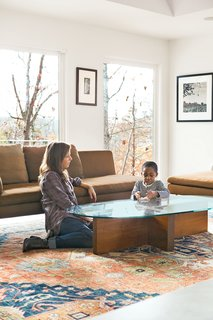 Birdsall plays with her son Atticus in the living room next to a Charles sofa from B&B Italia. Formwork also designed the coffee table—fitting, since the architects come from strong fabrication backgrounds.