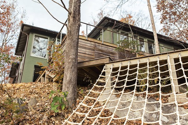 Another backyard hotspot is the deck, built around an existing boulder, where adults can lounge while the kids climb.