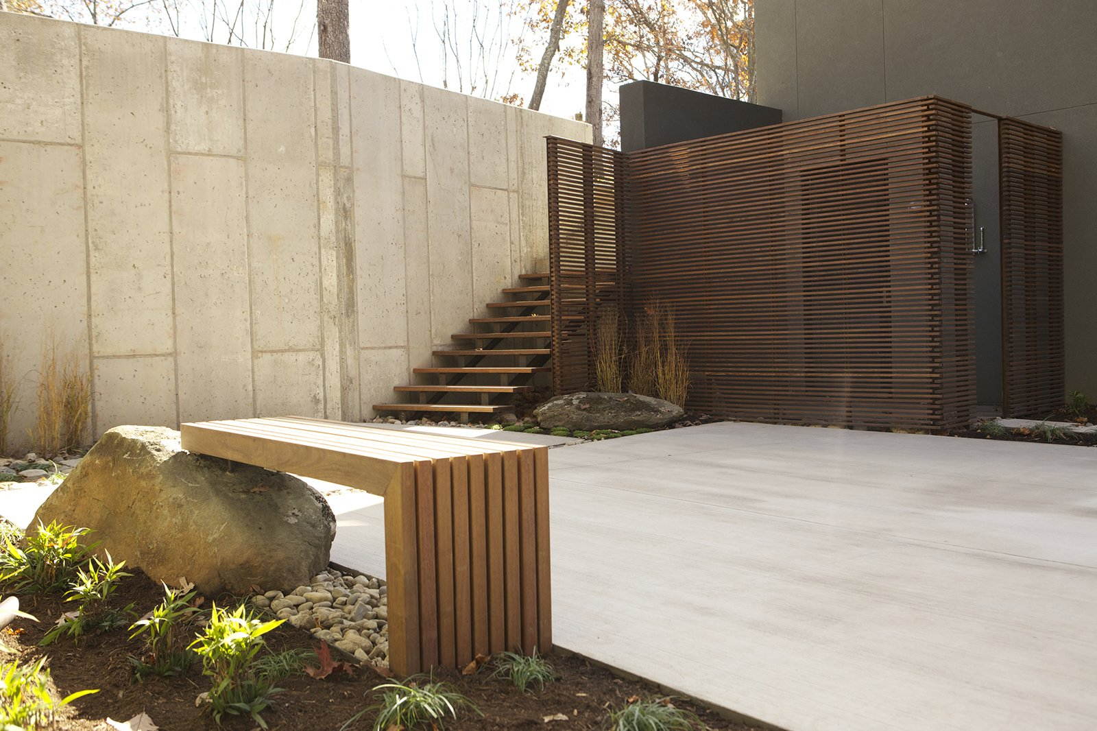Tagged: Outdoor, Concrete Patio, Porch, Deck, Large Patio, Porch, Deck, Concrete Fences, Wall, Horizontal Fences, Wall, and Wood Fences, Wall.  Photo 15 of 16 in How This Landscape Design Made a Home as Fun as a Playground