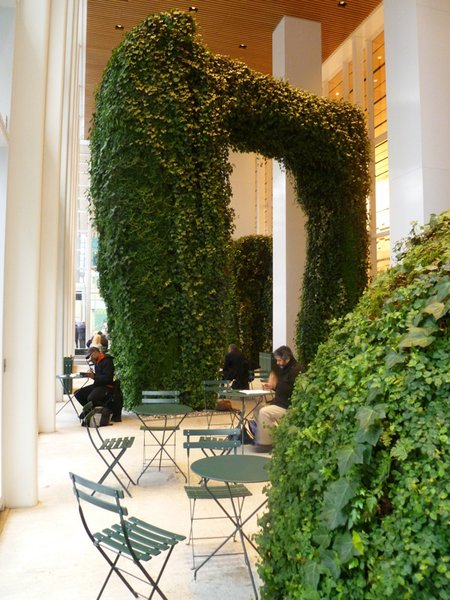 """The Urban Garden Room brings nature inside—in this case to the lobby of the Bank of America Tower in midtown Manhattan. Inspired by the lush fern canyons in Humboldt County, California, Ruddick collaborated with her mother, the artist Dorothy Ruddick, to create imposing, monolithic sculptures that then were covered with ferns, mosses, and vines. """"When you go there, people are very quiet,"""" Ruddick says of the space, which was completed shortly before her mother died in 2010. """"If they're talking, all of a sudden they stop. It smells like ferns and earth, and it's a little humid. It's a very quiet place, and it feels very healthful."""""""