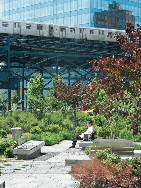 """Ruddick's design for Queens Plaza in New York helped transform a neglected space into an easily navigable gathering spot. The concrete bases beneath the benches appear to """"pop up"""" from the ground, Ruddick says. """"It required a lot of design to make everything integrate."""""""