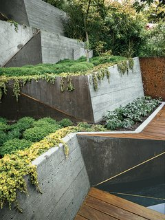 Board-formed concrete retaining walls double as ramps from the deck to the garden's highest point.