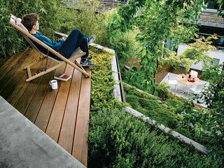 An Architect Sculpts Out a Tadao Ando-Inspired Backyard - Photo 2 of 4 - A small terrace outfitted with an H55 easy chair by Björn Hultén offers a view of the San Francisco Bay.