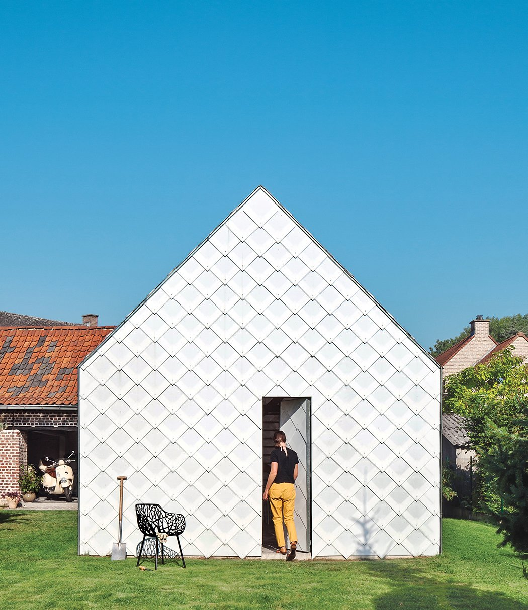 Architect Indra Janda hand-cut sheets of polycarbonate into 15¾-inch square shingles and clad the entire timber structure—a gabled roof and walls—with them. Tagged: Grass, Trees, and Shed & Studio.  ZOLLAMT by Can D Lirium from Inexpensive Gabled Garden Shed in Belgium