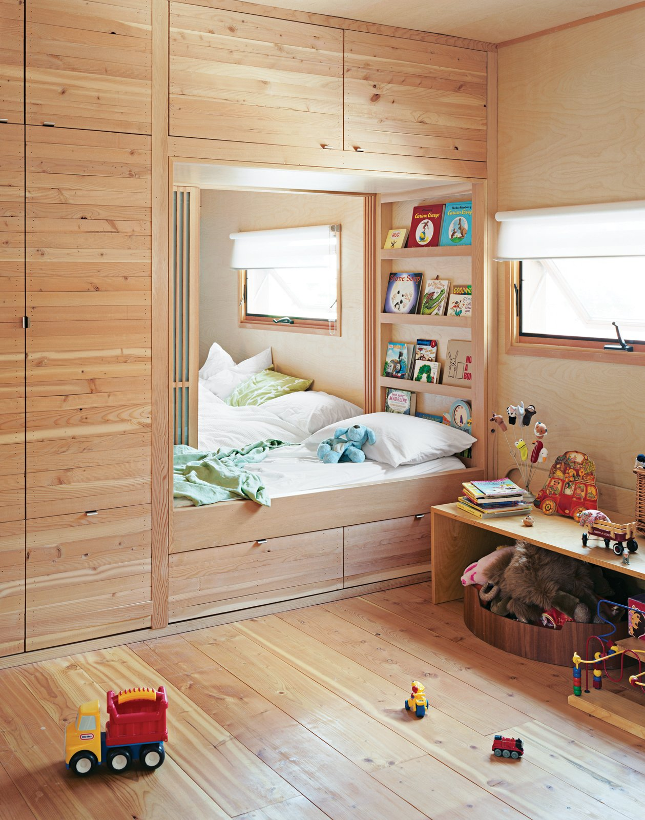 Only a set of sliding doors separates the kids' room from the master bedroom in a Toronto, Ontario, home. When the time is right, there's a track inlaid in the ceiling for a four-panel bifold wall to divide the space into two private rooms for the children.   Read the whole story here.  Photo 11 of 17 in Inside Job