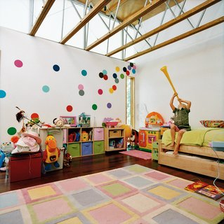 Opened House - Photo 7 of 7 - Ella's bedroom sports walls covered in polka dots that JJ hand-cut from fabric.