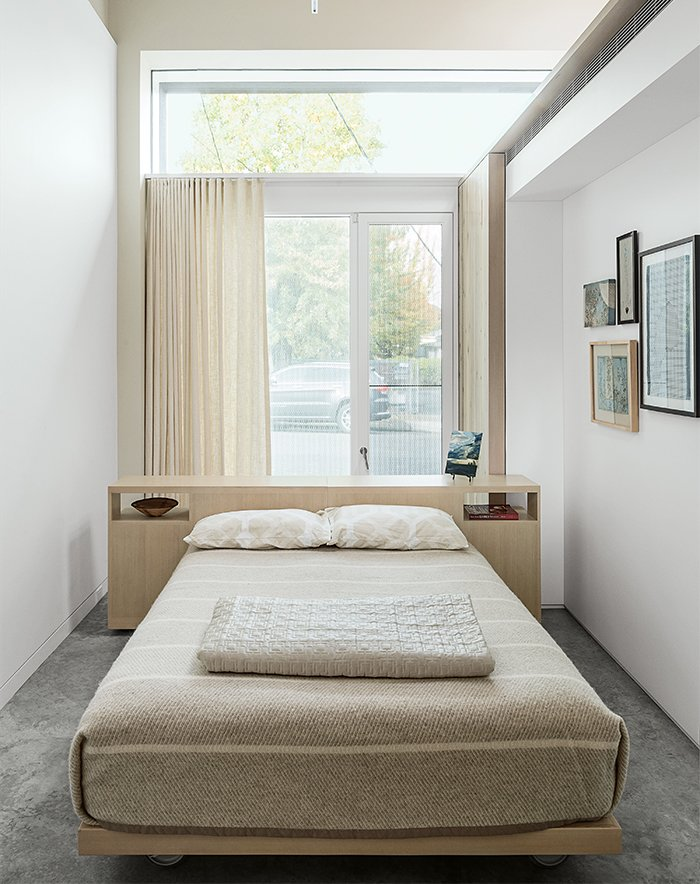 The guest bedroom features a custom bed and headboard by Henstein's Custom Cabinets of Clackamas, Oregon, outfitted with bedding from the Terra Nova collection by Jack Lenor Larsen for Martex.