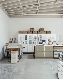 This Light-Filled Industrial Renovation Plays Host to Live Music - Photo 6 of 11 - Rolling cabinets by Sandusky proved a handy storage solution in Hutchins's studio.