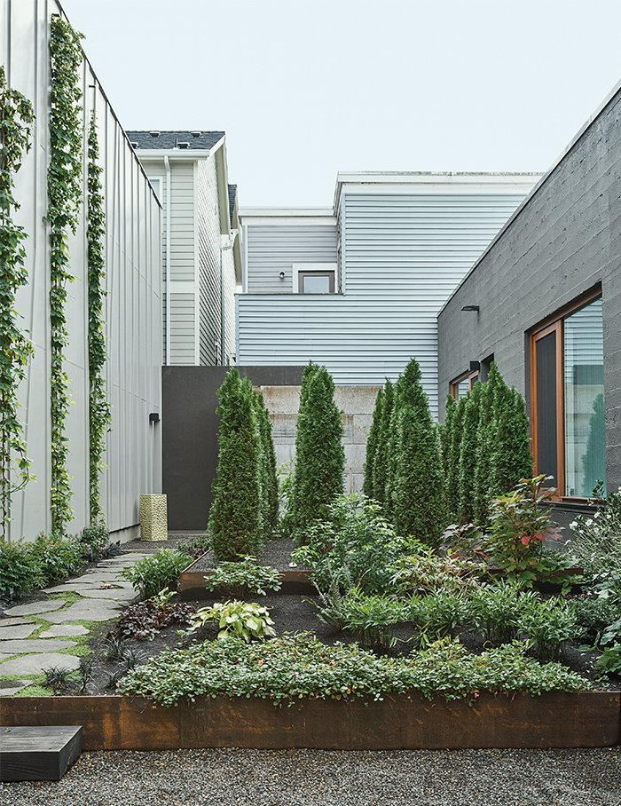 "Hutchins and Montague worked with Samuel H. Williamson Associates Landscape Architecture on the garden, which is planted with sword ferns, vine maple, and wild ginger. ""When we look at it from the bedroom, it's our private little forest,"" Montague says. Modern Spaces in the Pacific Northwest by William Lamb"
