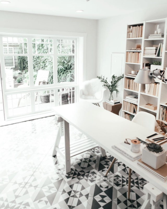 Andrea McClean took a garage in Vancouver and turned it into a minimalist work area. The designer credits the geometric tile and reclaimed windows for making the space pop.