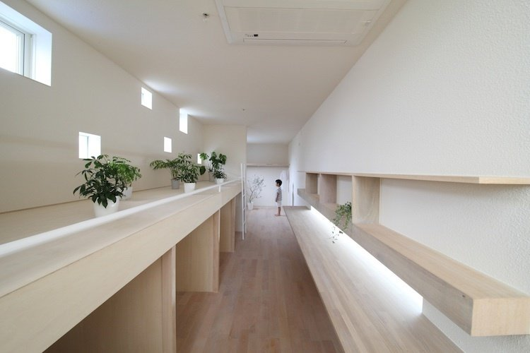 "Imai House by Katsutoshi Sasaki + Associates  ""These windows were positioned in front of the children's bedroom to give them their own personal scenery,"" says Sasaki.   Photo provided by Katsutoshi Sasaki + Associates  Photo 3 of 7 in Minimal Home on a Narrow Plot in Japan"