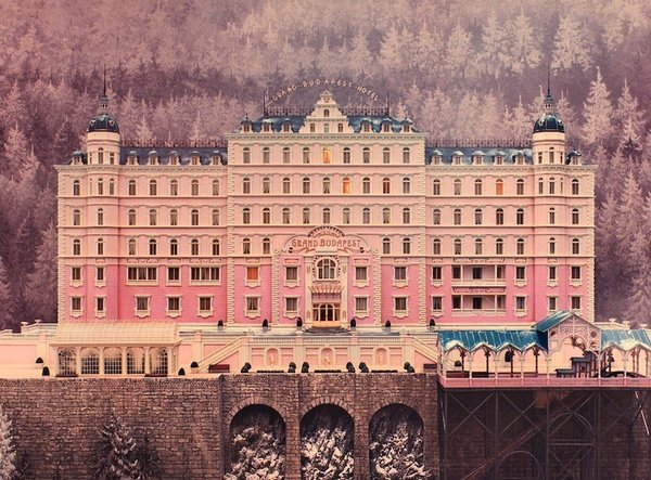 Exterior of the Grand Budapest Hotel, created with miniatures. One place in particular loomed large as an influence, the Grand Hotel Pupp, the gem of Karlovy Vary, a famed spa town in the Czech Republic that hosts an annual film festival. It's part of a strip of pastel-painted buildings on the Slovenska River in the city center, all painted in shades of tangerine, pistachio and bright yellow ochre that inspired Stockhausen. He says the exterior of the Pupp is the closest thing to the Grand Budapest.