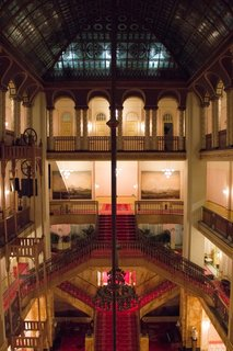 "Interior of the Grand Budapest Hotel. Anderson stumbled upon the Görlitzer Warenhaus, an abandoned department store in Görlitz. This ""tremendous find,"" according to Stockhausen, made building an interior possible within his budget, and the production crew build an entire hotel lobby inside."