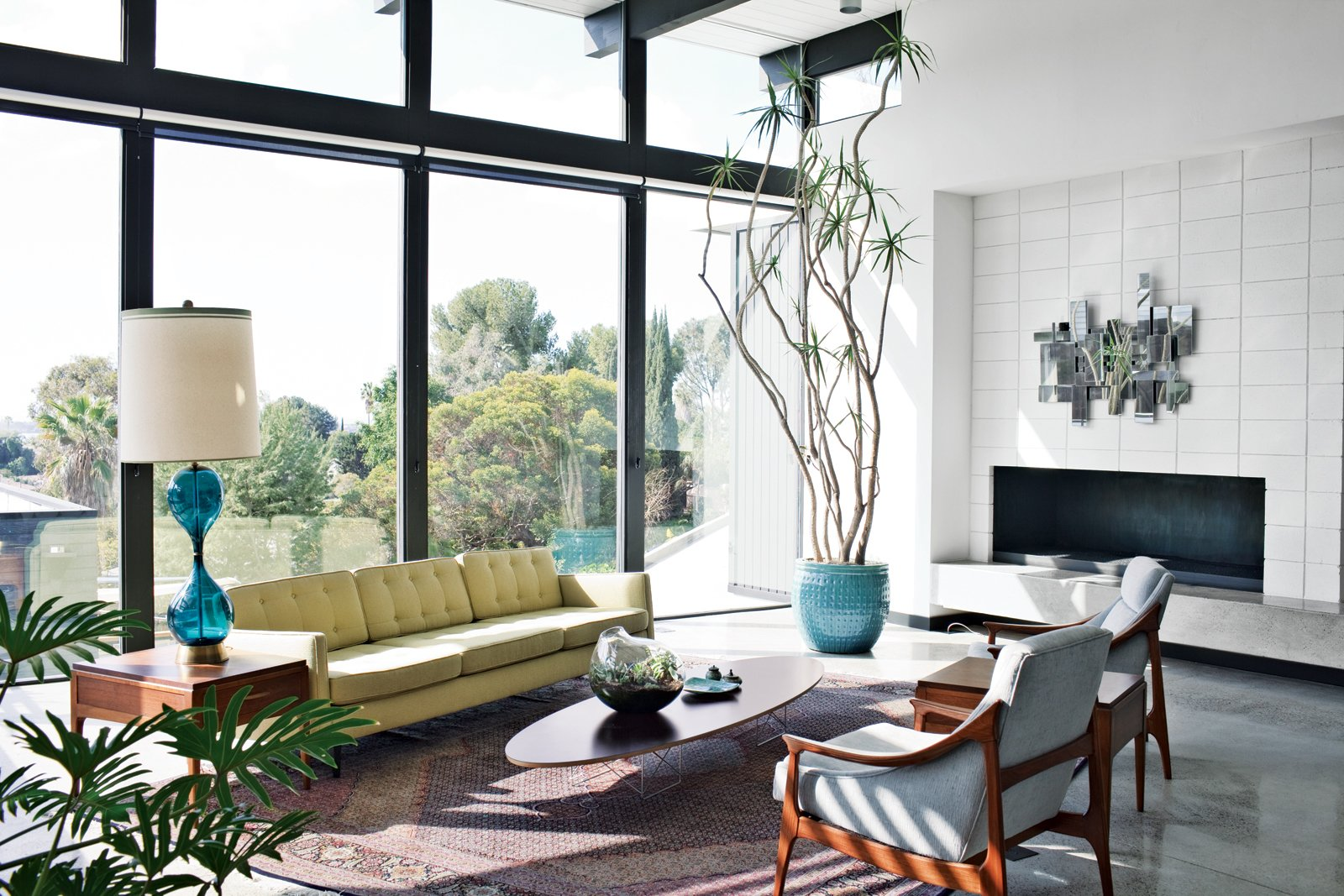 A Nelson sofa sits on a handmade Persian Mahi rug in the living room.  Homes for the Whole Family  by Matthew Keeshin from The First LEED Gold-Certified Family Home in San Diego