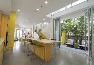"A Sustainable ""Case Study"" House in California - Photo 1 of 8 - The kitchen and dining area opens onto a patio. Photo by Ken Pagliaro Photography."