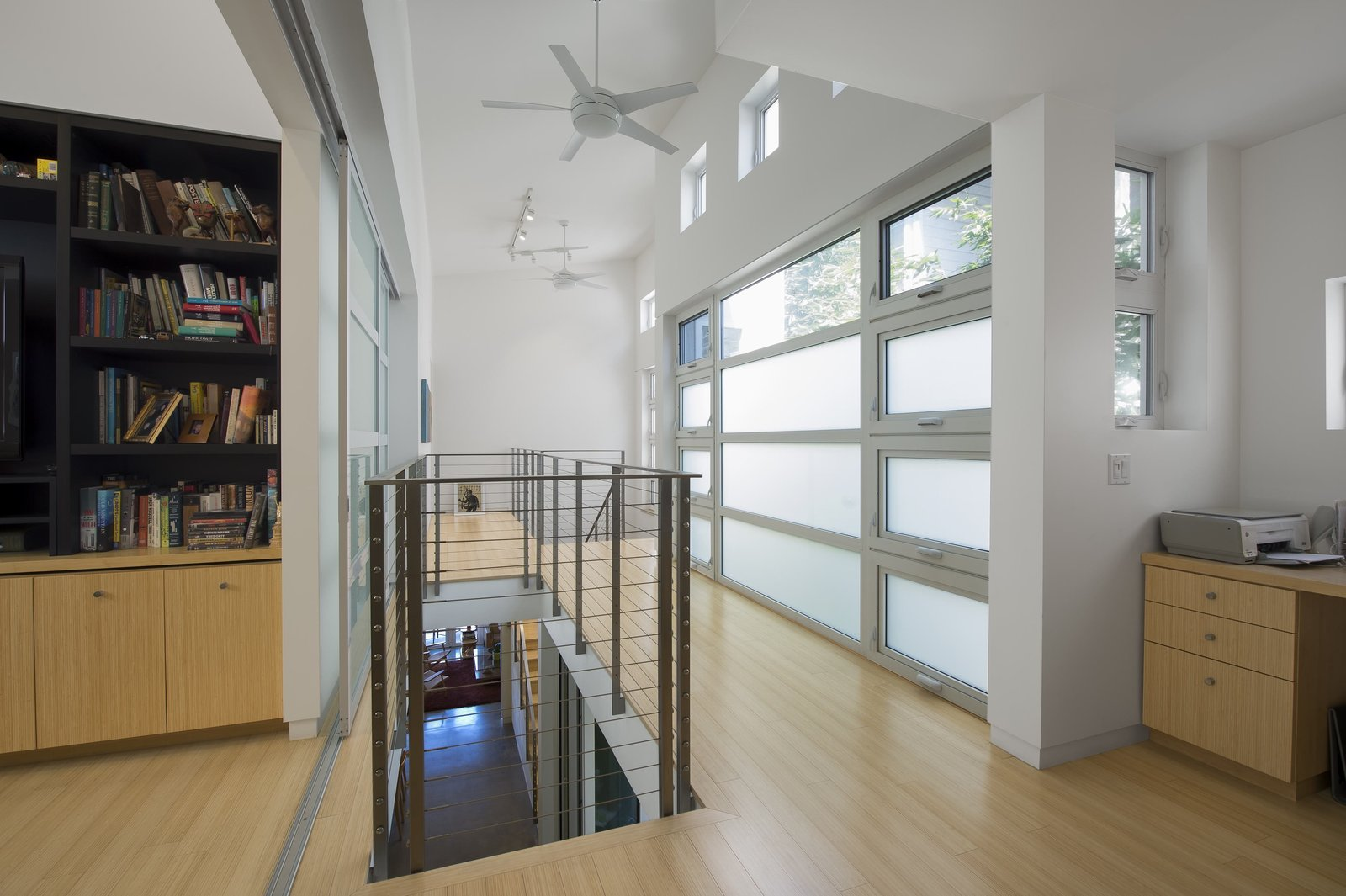 "Upstairs, passive ventilation gets an assist from high-efficiency Emerson ceiling fans. Photo by Ken Pagliaro Photography.  Photo 5 of 8 in A Sustainable ""Case Study"" House in California"