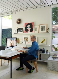 This Sparkling New Home Is a Perfect Remake of Classic Sarasota School Modernism - Photo 6 of 13 - Pirman, an illustrator, works on a vintage Florence Knoll table in his studio at the front of the house.