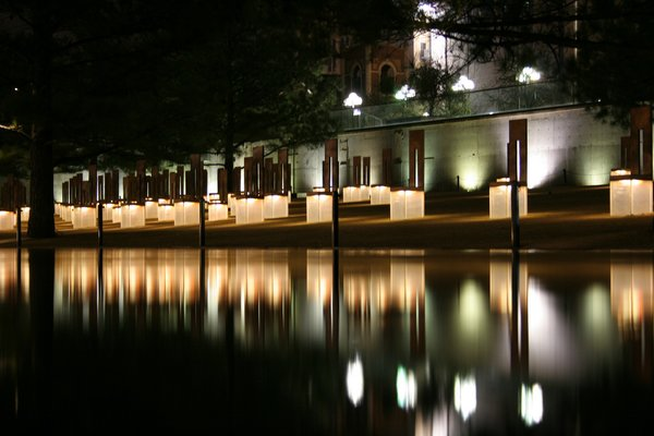 5. Oklahoma City National Memorial & Museum (Oklahoma City, United States): Designed by Hans and Torrey Butzer with Sven Berg<br><br>A grid of illuminated glass-and-bronze chairs, laid out in rows to represent which floors of the Alfred P. Murrah Federal Building each victim was during the bombing, light up at night, becoming beacons of hope. Two gates mark the edges of plaza and memorial; the 9:01 Gate (the last moment of innocence) and the 9:03 Gate (the start of the healing process). Photo by Jimx.