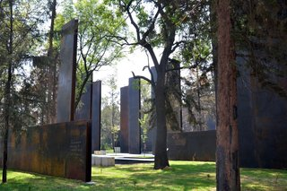 10 Inspiring Modern Memorials - Photo 10 of 10 - 10. Memorial to Victims of Violence in Mexico (Mexico City, Mexico): Designed by Gaeta Springall Arquitectos<br><br>This array of 70 steel slabs may not be the most inviting setup at first glance, but it's actually a massive interactive display; visitors can etch their own stories into these massive pieces of metal, creating a constantly changing repository of stories.