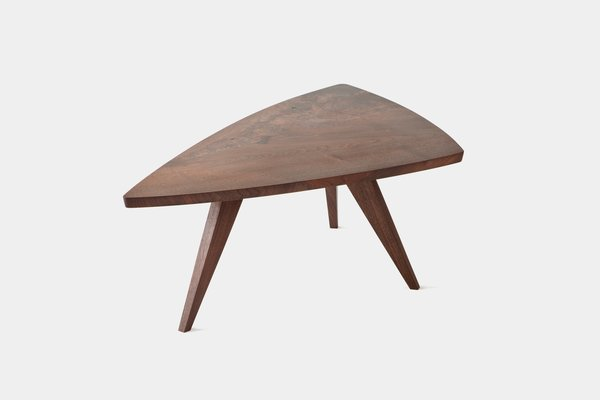 Splay-Leg Table<br><br>Impressed by the simple elegance and understated forms of his work, Hans and Florence Knoll added Nakashima's work to their roster. This table was designed in 1946 with a low-sheen finish and live grain patterns. Photo courtesy George Nakashima Woodworker, S.A.