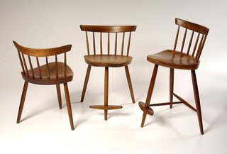 Mira Chair<br><br>These three-legged chairs were designed in 1950 for George's daughter, Mira, who now runs George Nakashima Woodworker, the company that carries on the Nakashima legacy. Photo courtesy George Nakashima Woodworker, S.A.