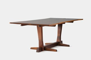Conoid Table<br><br>Pieces from this series, named after Nakashima's Conoid workshop, which he opened in 1957, focus on free-edge forms, respecting and conforming to the natural shape of the wood, and often employ cantilever technology. Photo courtesy George Nakashima Woodworker, S.A.