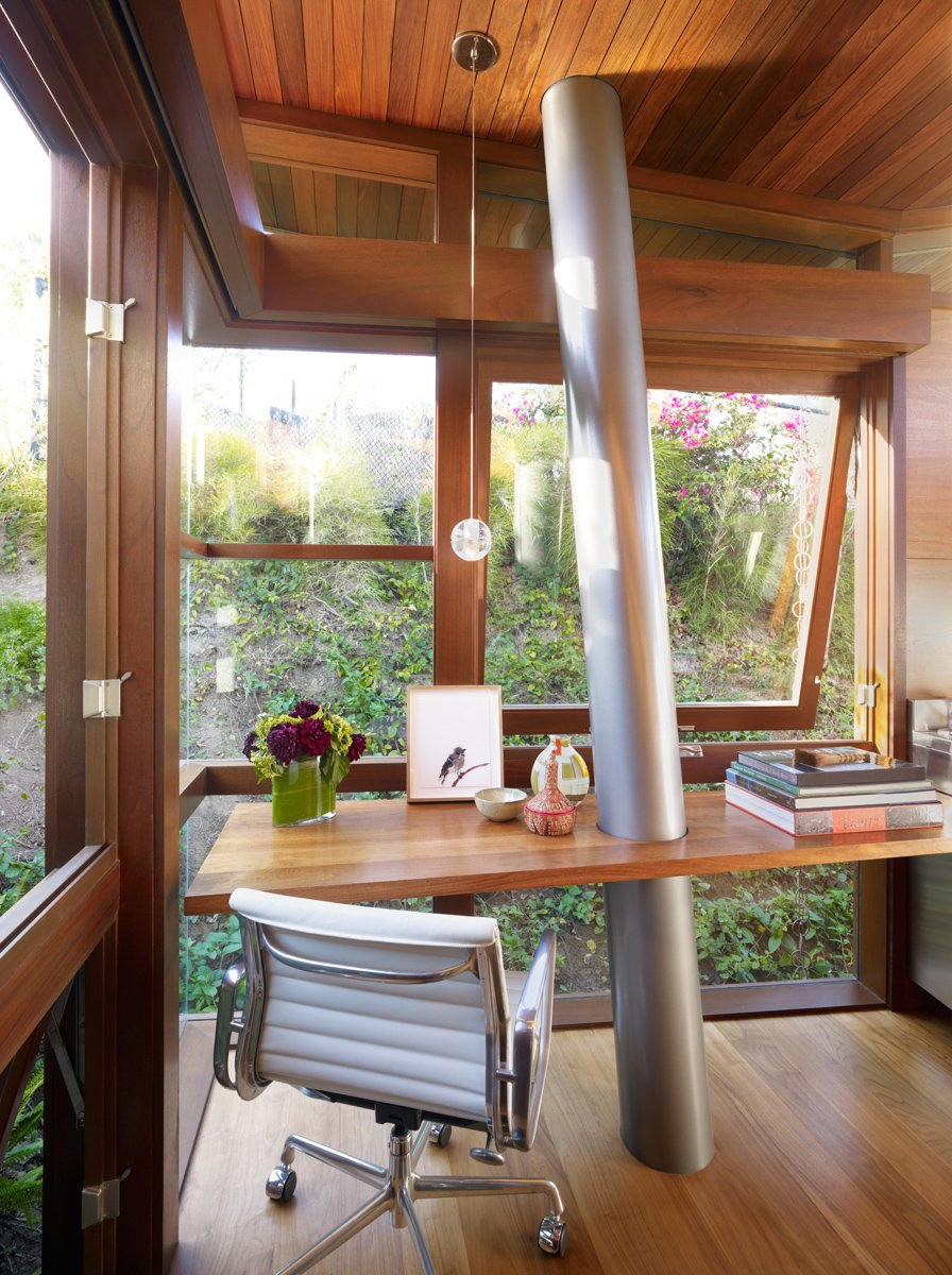 Materials and craft play a significant role inside and out. The columns are Type 316 stainless steel – almost nautical grade. Floors and walls are walnut; windows are mahogany. Tagged: Office, Desk, and Study.  Photo 7 of 11 in An Atypical Tree House