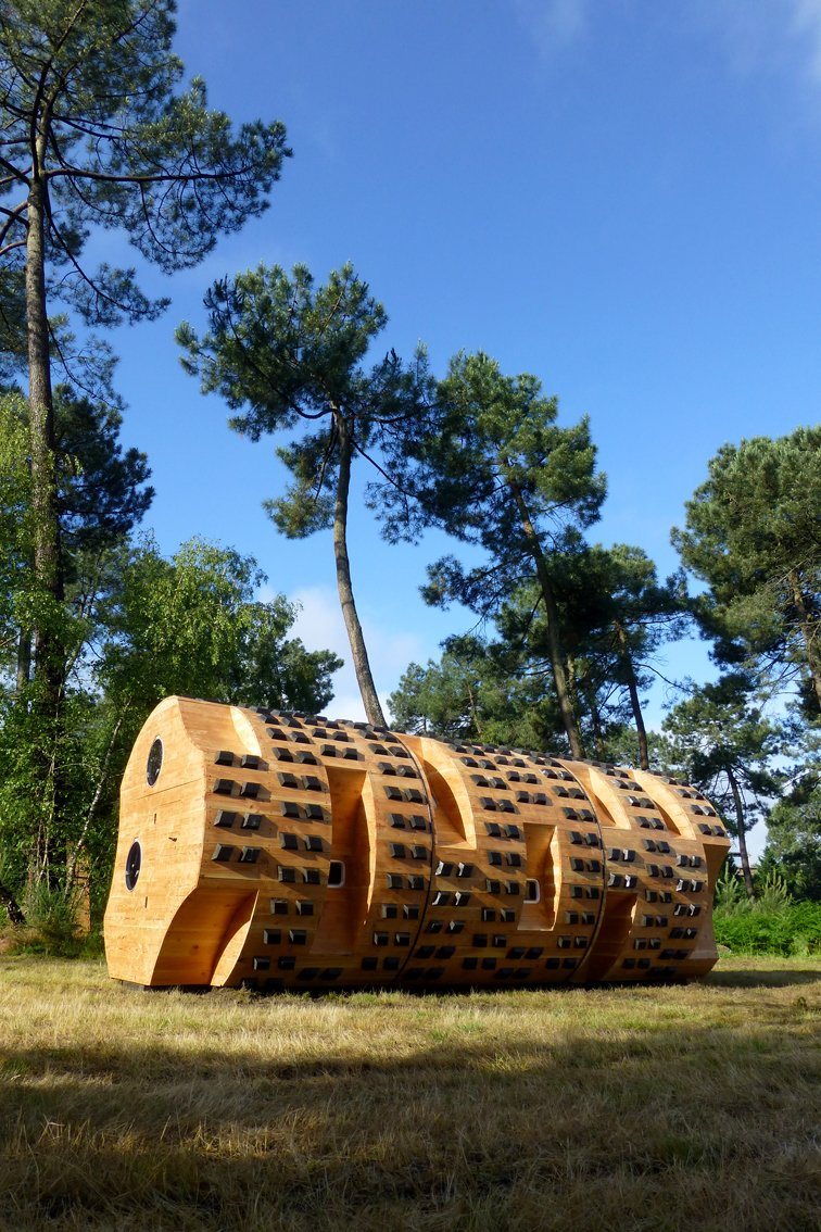 "A different kind of log cabin, ""Le tronc creux"" is an abstract wood cylinder concieved by Bruit du frigo Thidet and built by Zebra3.  Photo 5 of 8 in Tiny Vacation Shelters in the French Countryside"