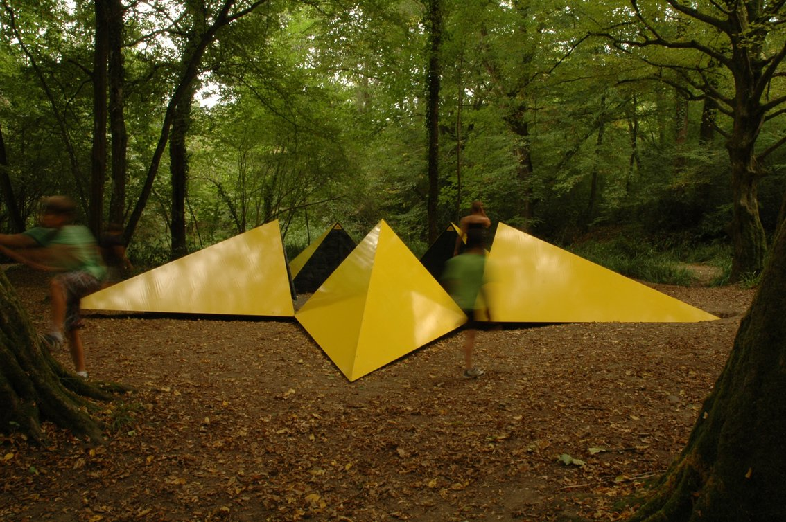 "Sréphane Thidet conceived of ""La belle étoile,"" a yellow, star-shaped shelter made of stainless steel and wood.  Photo 6 of 8 in Tiny Vacation Shelters in the French Countryside"