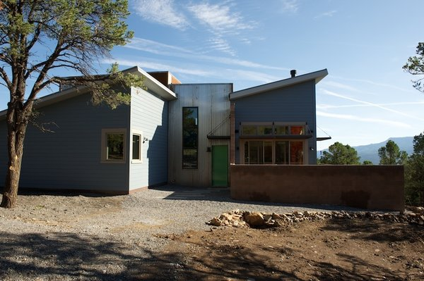 The exterior is constructed of corrugated steel and fiber-cement siding by Hardie Boad. The use of these fire-retardant materials gave the couple a break on the insurance premiums that they pay to live in this area of Colorado's San Juan Mountains, where wildfires have been known to break out. Photo by Barry B. Doyle.