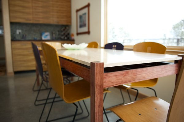 Barry also built the dining table, which seats eight. The top was made from figured maple; the legs are bubinga. Photo by Barry B. Doyle.