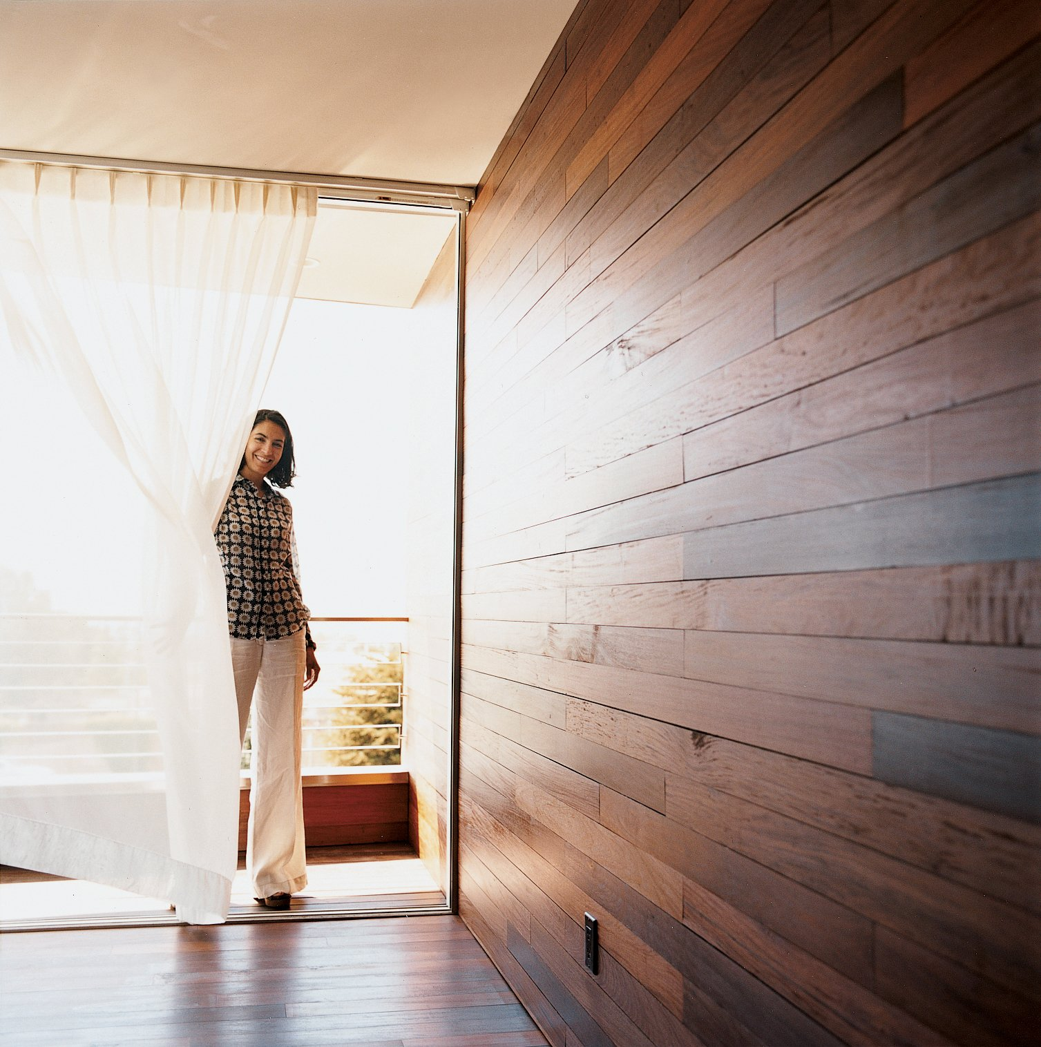 The Mariscals' bedroom opens out onto a small triangular patio. The exterior's ipe cladding also makes up the walls and floor of the master bedroom, further inviting the outside in. Tagged: Doors and Exterior.  Photo 7 of 7 in Sebastian Mariscal's Wood Architecture from Double the Pleasure