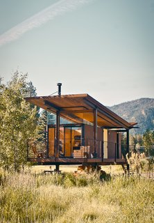 "101 Best Modern Cabins - Photo 83 of 101 - The steel-clad Rolling Huts designed by Olson Kundig Architects in Manzama, Washington, sit lightly on the land thanks to wheels that allow the tiny residences to ""hover"" above the site, optimizing views of the landscape. Photo by Derek Pirozzi."