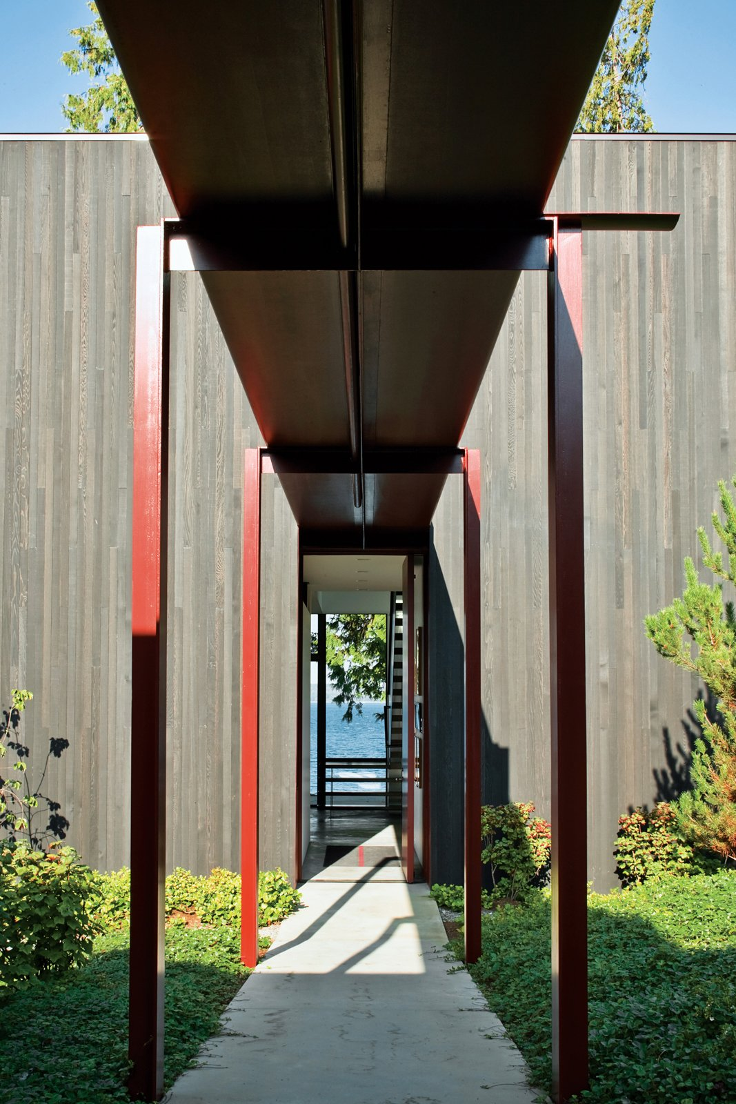 The steel canopy protects the residents from Seattle's notoriously rainy weather as they walk from the entry gate to the front door.  House of Steel  by Diana Budds from Olson Kundig Houses