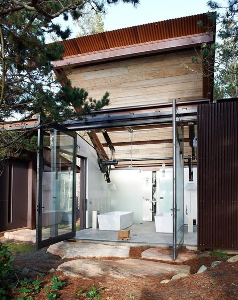 """According to the architects, the Shadowboxx house """"purposely confuses the traditional boundaries between a built structure and its surroundings."""" The roof over the batroom can be raised an lowered at will. Tagged: Exterior and House.  Dream by Tabitha Rae from A Stop Motion Video of a Shape-Shifting House"""