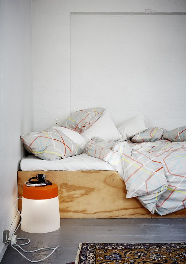 Danish textile designer Margrethe Odgaard's duvet cover set ($49.99 for three pieces) is paired with Rich Brilliant Willing's indoor/outdoor LED stool lamp ($69.99).  60+ Modern Lighting Solutions by Dwell from Ikea Furniture Designed for Small Spaces