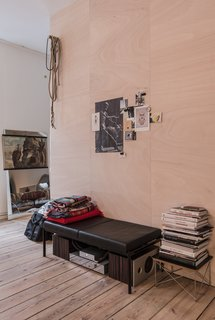 Freunde von Freunden and Vitra's Berlin Apartment - Photo 3 of 9 - Salon of the Freunde von Freunden X Vitra ApartmentUnable to remove the center wall, architect Etienne Descloux instead created a wood-paneled centerpiece for the apartment.Photo by Steve Herud