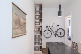 Freunde von Freunden and Vitra's Berlin Apartment - Photo 6 of 9 - Kitchen of the Freunde von Freunden X Vitra ApartmentArchitect Etienne Descloux adjusted the original bathroom design to provide more space for storage in the kitchen. Bike by Mikili, flowers by Marsano.Photo by Steve Herud
