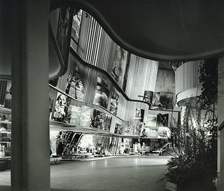 Design Icon: 10 Buildings By Alvar Aalto - Photo 2 of 11 - Finnish Pavilion at the 1939 World's Fair (New York, USA: 1939)<br><br>It's fitting that a man often called one of Finland's greatest architects would cap his most successful decade of work with a structure that celebrated his country's contributions to the world. Within the compact, four-story structure, photos of landscapes, people and products looked out over curvaceous, wood-slatted walls, a flowchart of Finnish industry capped off by airplane propellers spinning like fans from the ceiling.