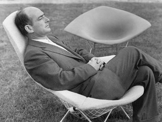Design Classic: Bertoia Seating Collection - Photo 5 of 9 - Bertoia, here shown sitting in one of his famous chairs, designed in 1951 for Knoll.