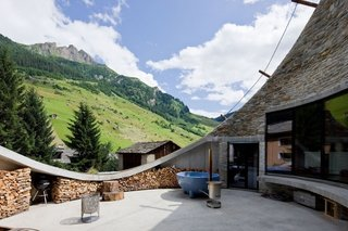 13 Epic Alpine Retreats We're Swooning Over - Photo 11 of 13 - Villa Vals is subtly out carved from an alpine slope in Vals, Switzerland. The unique design by SeARCH and Christian Müller Architects provides both a comfortably sized patio and stunning mountain views while remaining visually unobtrusive in the pastoral landscape.