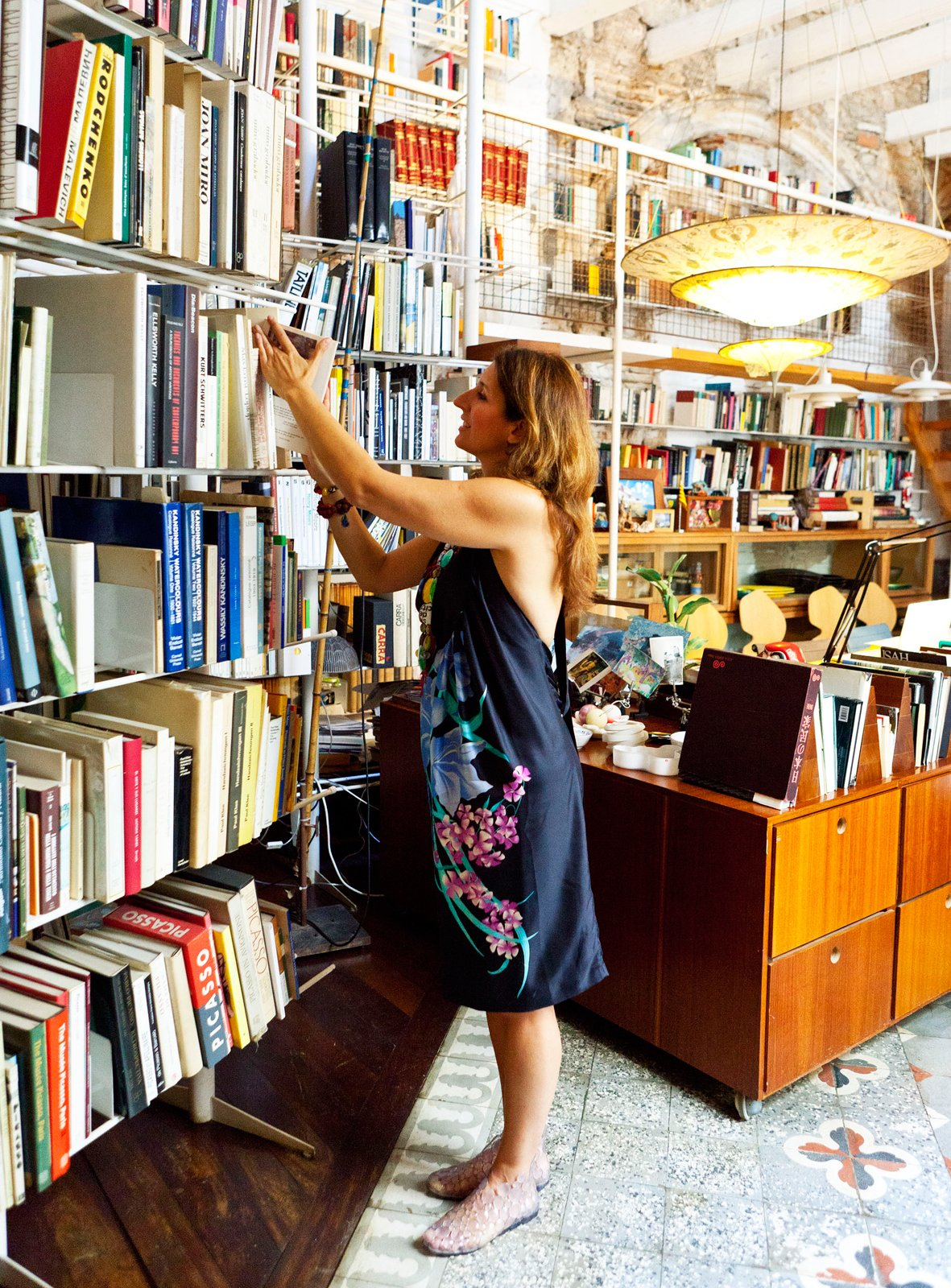 Tagliabue and her husband, enthusiastic book lovers, collected thousands of volumes for their library.  Photo 21 of 23 in The Barcelona Home Like No Other
