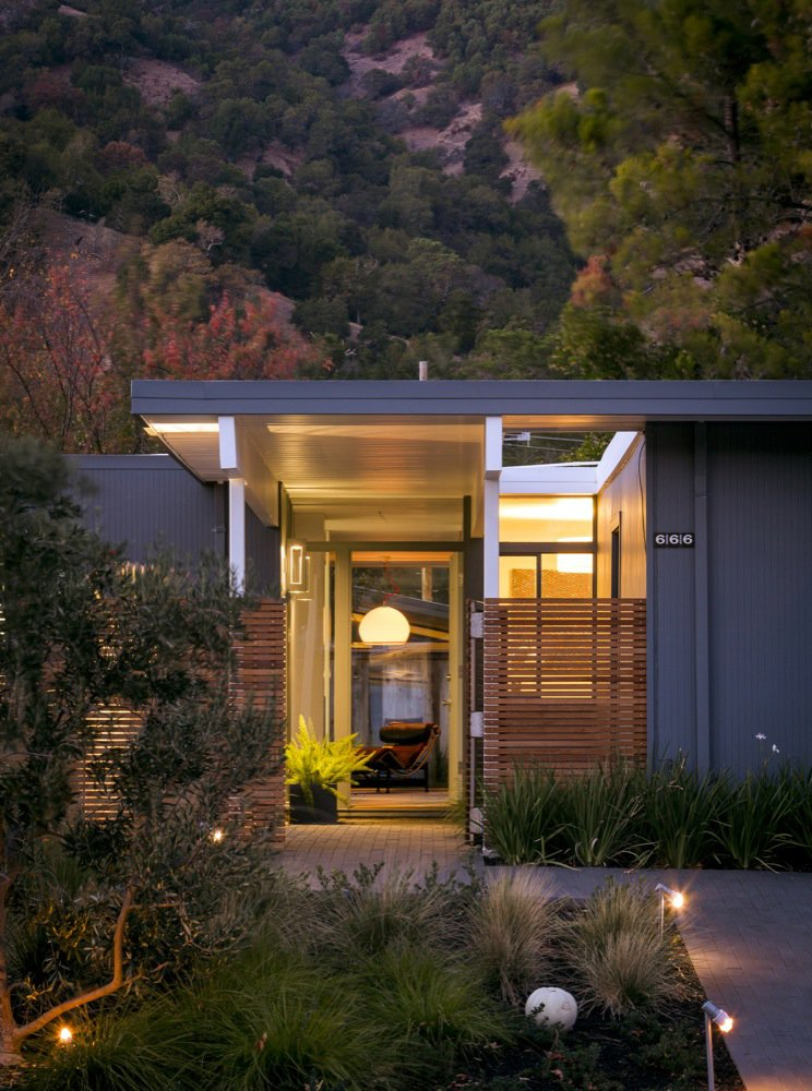 The 1,570 square-foot home's entryway features a slatted fence that diffuses light and adds privacy to Eichler's original design. Photo by: Scott Hargis Tagged: Exterior, Mid-Century Building Type, and House.  Modern Eichler Renovations by Allie Weiss from A Renovated Eichler Home in San Rafael, California