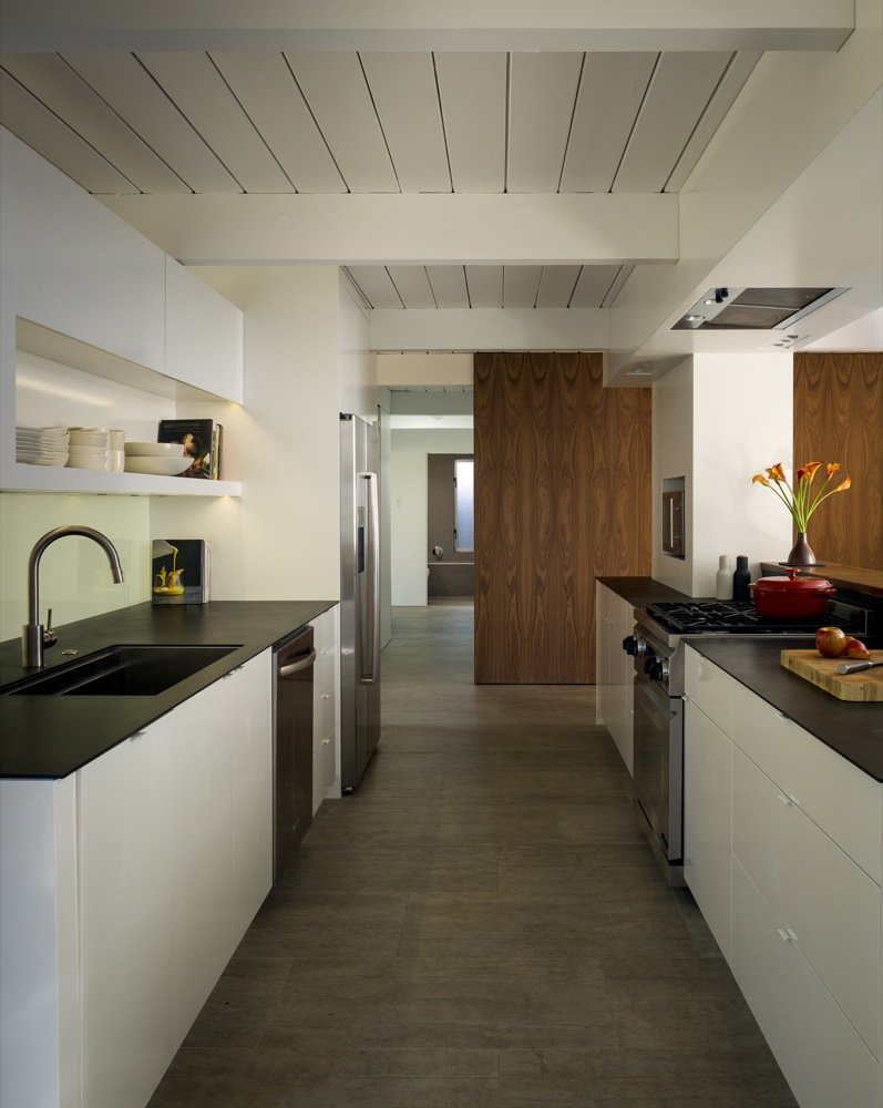 Building Lab's renovation of the home used the kitchen as the hub around which the home's public spaces were organized. Photo by: Scott Hargis  Midcentury Homes by Dwell from A Renovated Eichler Home in San Rafael, California